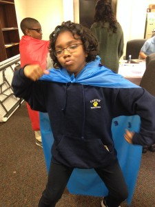 Carter Traditional student striking her best superhero pose!