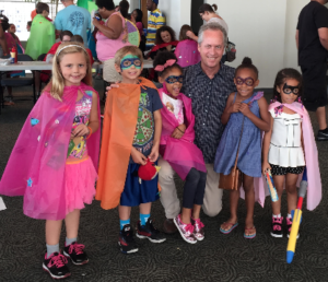 Mayor Fischer with some small superheroes.