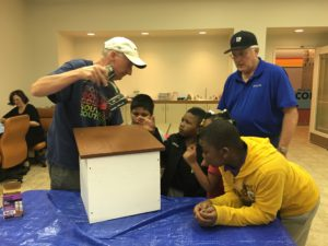 Students building a Little Free Library